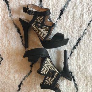 Platform heel with woven detail.
